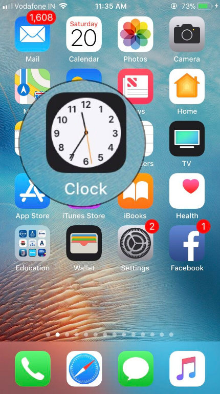 Tap on Clock App from your iPhone Home screen
